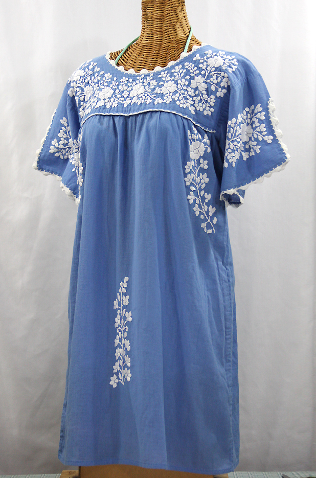 White dress with blue embroidery